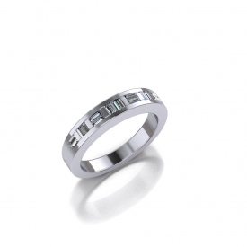 14kt white gold channel set band with baguette diamonds set both horizontally and vertically across the top.