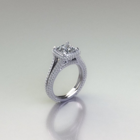 14kt white gold halo style engagement ring with a pave style split shank and halo, there are round brilliant cut diamonds set throughout the ring and the center diamond is a princess cut diamond.