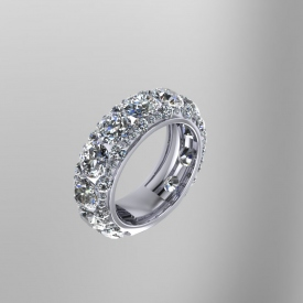 18kt white gold band with prong set round brilliant cut diamonds.