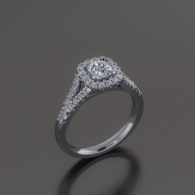14kt white gold engagement ring with a cushion shaped diamond center stone surrounded by a halo if diamonds, and a split shank with prong set round diamonds.
