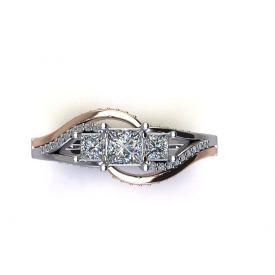 14kt two tone three-stone ring with the center diamonds being three princess cuts, the sides are swirled with white gold and diamonds, and an outer band of high polish rose gold with round diamonds set on the face.