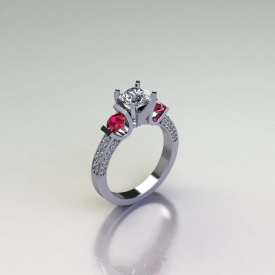 14kt white gold three-stone ring with white diamonds and ruby gemstone side stones.