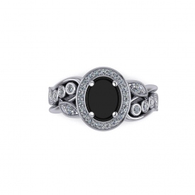 18kt white gold white diamond and black onyx fashion ring, the center is an oval shaped black onyx and the sides have leaf designs and bezels with round diamonds set throughout.